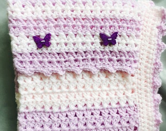 Baby girl car seat or crib blanket in shades of lilac and pink. Finished with a picot edging and butterflies. Pretty, unusual design