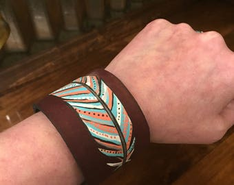 Leather cuff with painted western feather