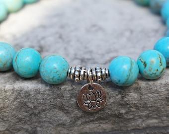 Ambition ॐ Turquoise Howlite Lotus Mala Bracelet