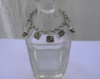Sterling silver and PMC skulls and charms bracelet.
