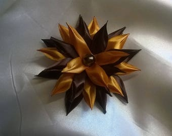 fabric flower made of satin ribbon chocolate and gold with a half chocolate Pearl Heart