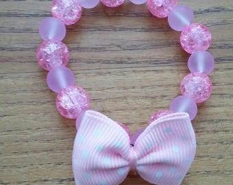 Pink girl purple and pink bow bracelet