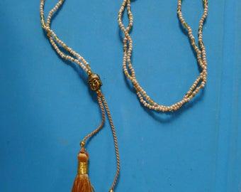 Golden beige glass camel tassel and Buddha necklace