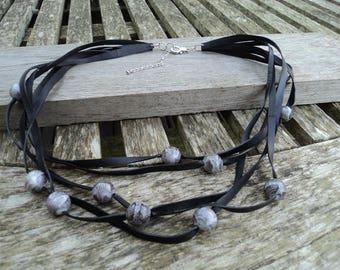 The Choker in inner inner and snake printed beads