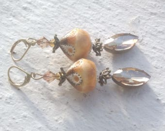 Earrings: Ceramic and champagne rhinestones