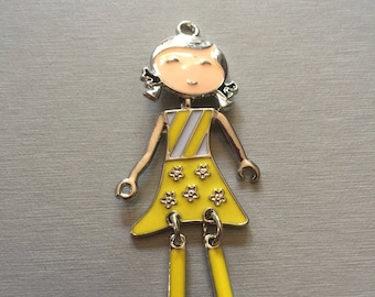 Yellow enamel articulated doll