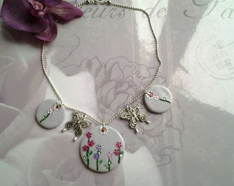 Floral butterfly on silver chain necklace