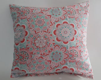 Pink and turquoise pillow cover; geometric patterns