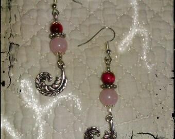 Earrings in rose quartz, Bull's eye and his pen