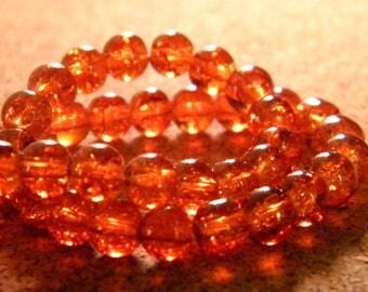 100 6 mm - dark orange - PE130 Crackle glass beads