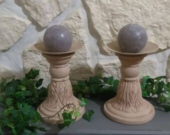 2 big patinated antique stone candlesticks
