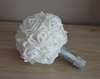 Bridal bouquet: Pink White and grey cuff and beads on the heart of roses