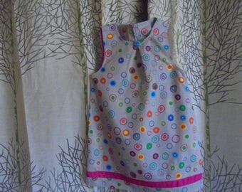 Cotton dress 2 years trapezoid shape, multicolored bubbles on a gray background.