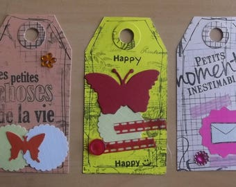 3 tags, 1 peach, 1 yellow and 1 Pink for your scrapbooking creations.