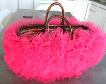 basket decorated with neon pink tulle