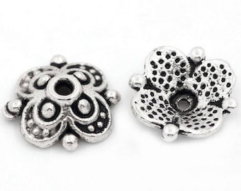 Small antique silver metal flower cups