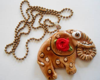 Elephant with big brown eyes pendant necklace.