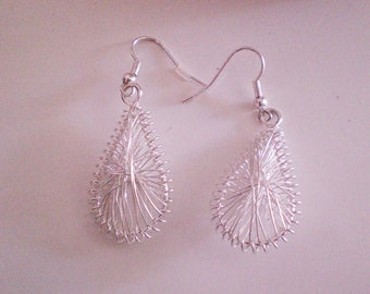 Beautiful earrings made of aluminum wire