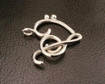 I said heart (key of Sun and fa) silver. Heart pendant, personalized music