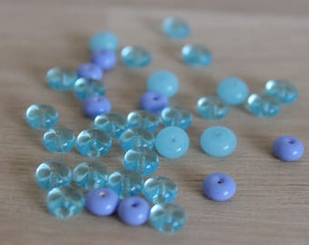 30 flat 6 mm in shades of blue seed beads