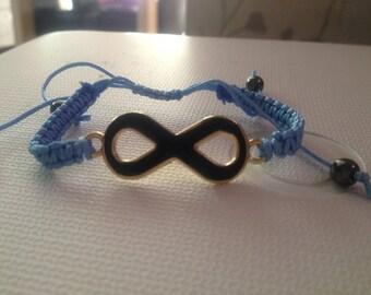 Blue bracelet with black infinity symbol