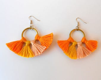 Earrings with fringe orangey-yellow-pink on copper ring