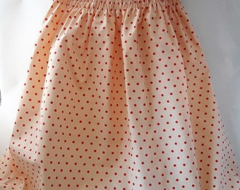 dress has smocking and red dots