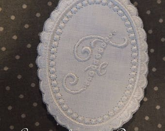 "Embroidered Monogram ""F"" in beaded Medallion"