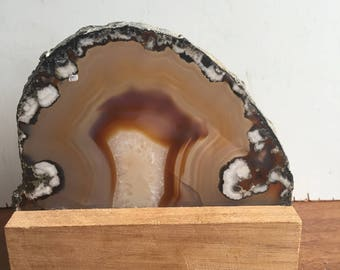Slice of agate mounted on wooden base