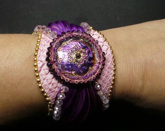 The jewel of the dragon, an embroidered bracelet hand woven
