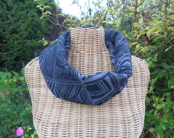 snood made with beige khaki black fabric with geometric patterns