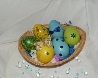 Decorative Easter eggs with wicker basket