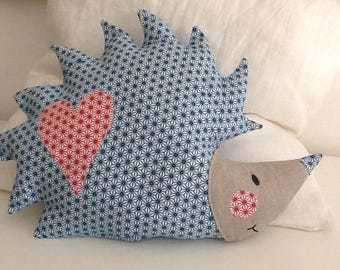 Hedgehog shaped pillow, multicolor fabric.