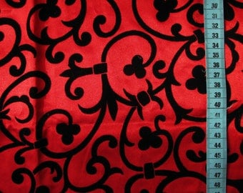 Coupon red acetate and scrolls with flowers in Velvet black 52cm x 122cm
