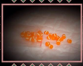 Mini transparent Orange macaroon and his slice of vanilla