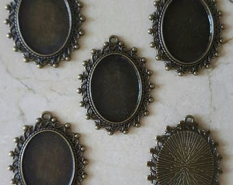 set of 5 holders vintage cameo cabochons.