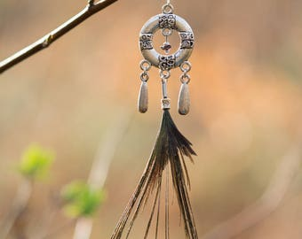 Maya wheel earrings, charms and Peacock feather
