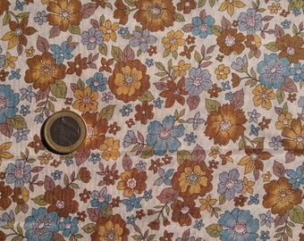 mustard-colored ruffled fabric large blue Brown flowers
