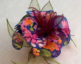 Large fabric flower hairclip & feathers and beads