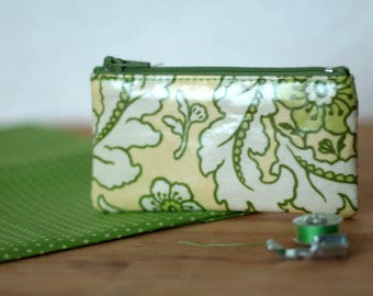 Purse with yellow and green patterned loyalty cards