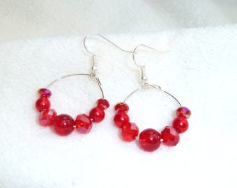 Red beads and hoop earrings