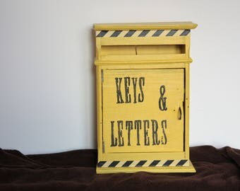 yellow box with key and wall letters