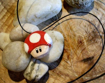 Red mushroom necklace.