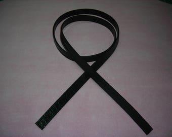 Shiny black crocodile grain cowhide leather strap.