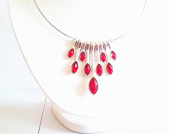 Necklace, pendant, pendant of red, silver tone metal.