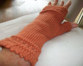 Coral knitted fingerless hand pattern top and bottom and thumb of soft yarn