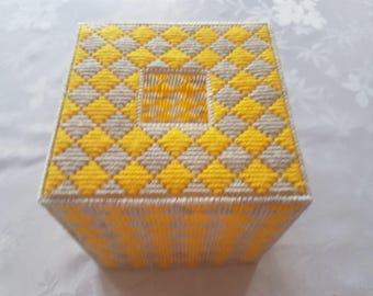 Yellow and gray tissue box