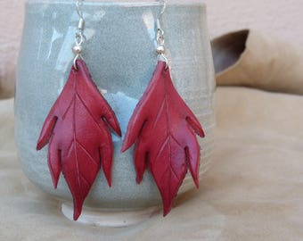 Large red leather leaf earrings