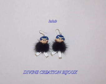 Earrings representing Minis character dressed in black fur