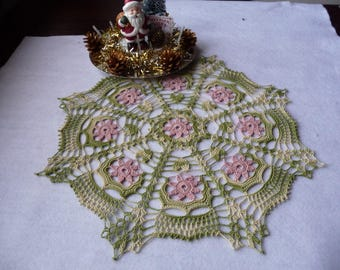 Handmade ombre green cotton and dusty rose lace doily.
